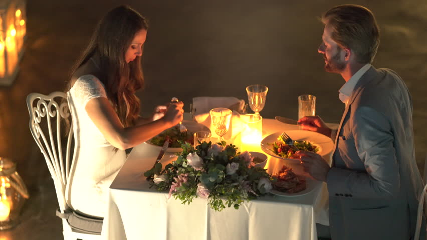 Arrange a candlelight dinner at home