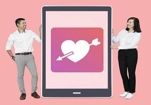 Cheerful couple showing online dating on a tablet