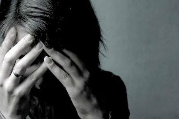 Depressed Woman Hands on Head
