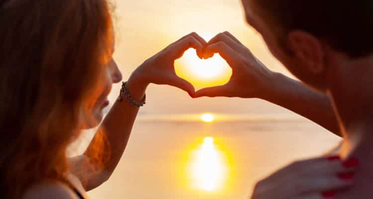 Couple hand with sunset
