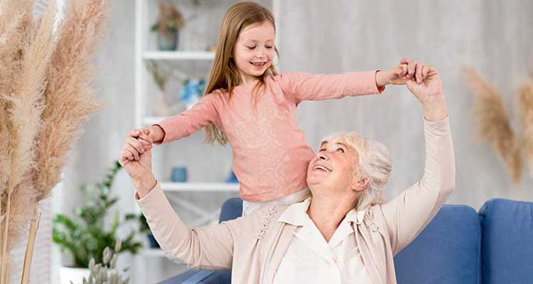 Grandmother playing with kid