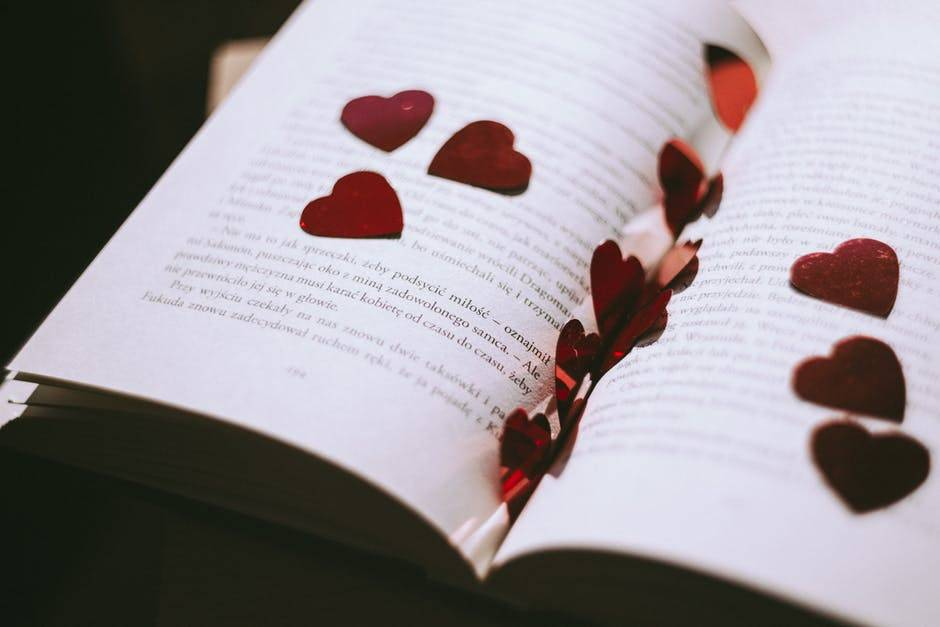 Heart cutouts on pages of a book