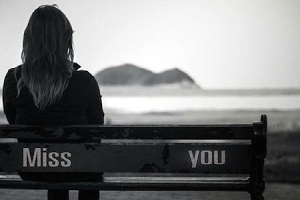 Woman on Miss You Bench