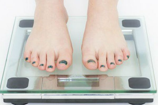 Woman on Weight Machine