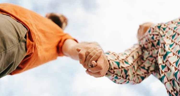 Couple holding hand together