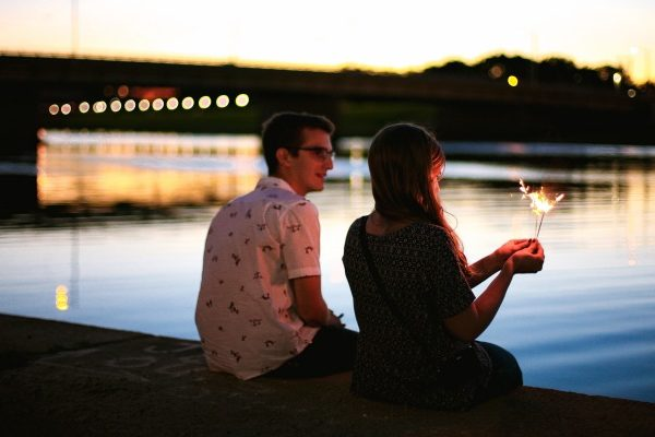 couple sitting on the river