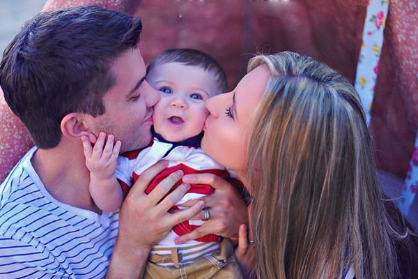 happy couple and baby