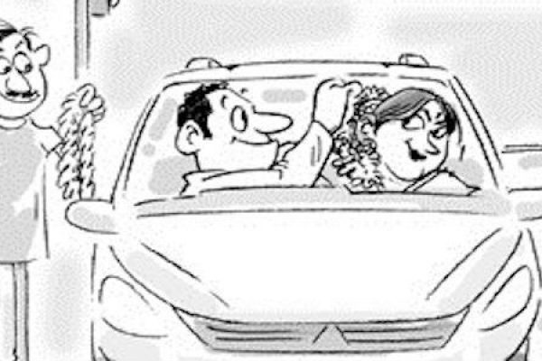 husband and wife in a car