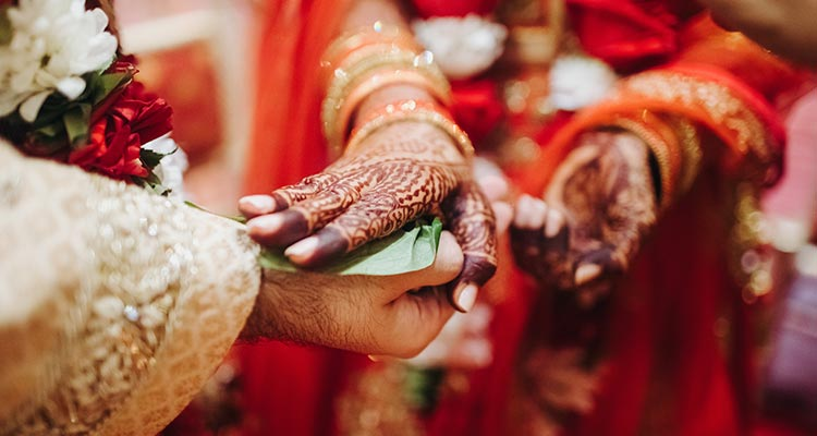 Couple hands during marriage