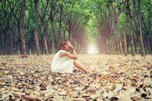 sad woman in forest