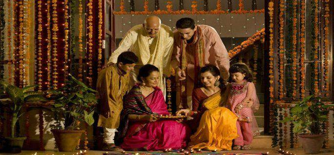 Indian family arranging diyas