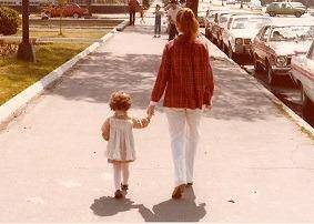 girl walking with nanny