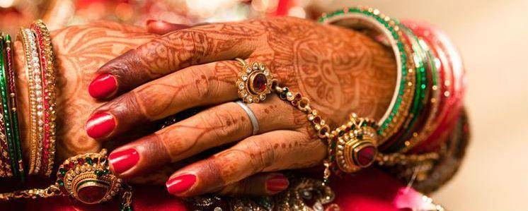 hands of an indian bride sitting