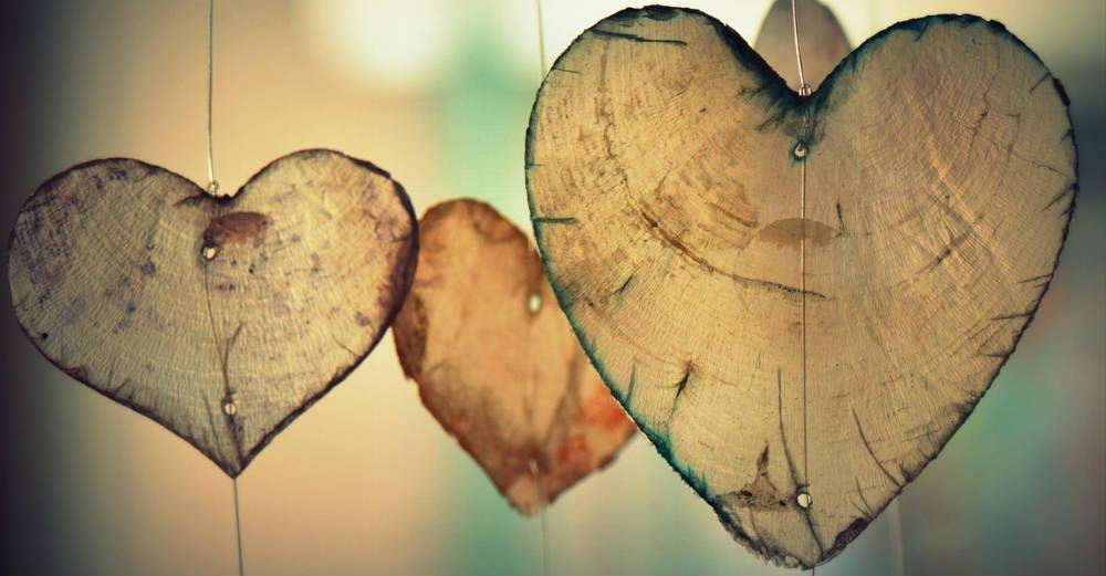 Hearts hanging by thread