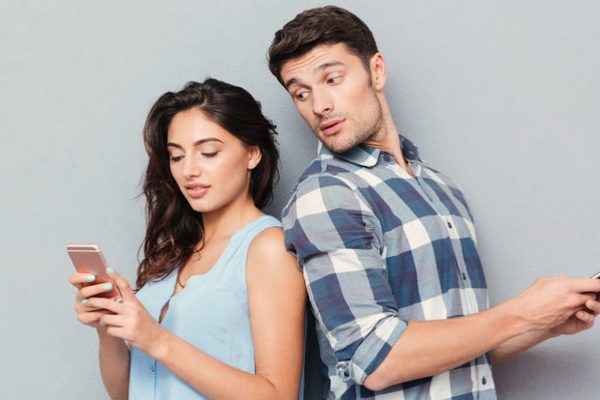 man looking into wife's phone
