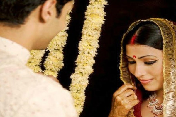 shy indian bride with groom
