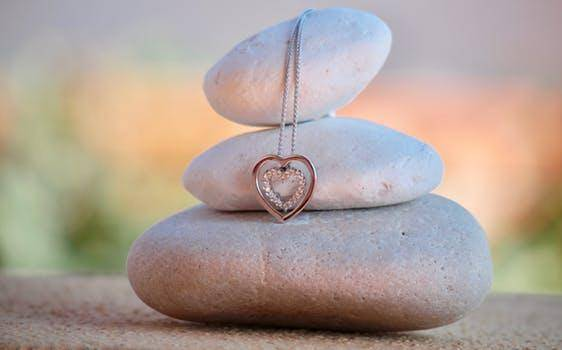 Heart pendant on stone pyramid