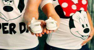 Parents to be with baby shoes