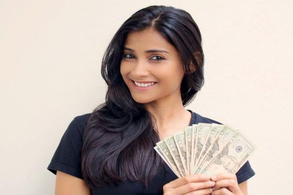 Young female executive holding money