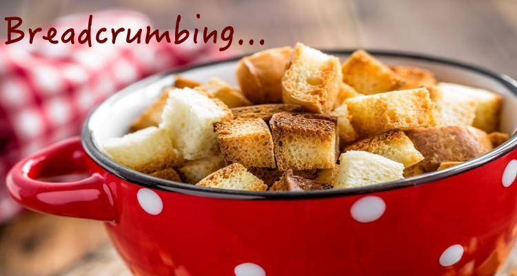Breadcrumbing written over red bowl of croutons