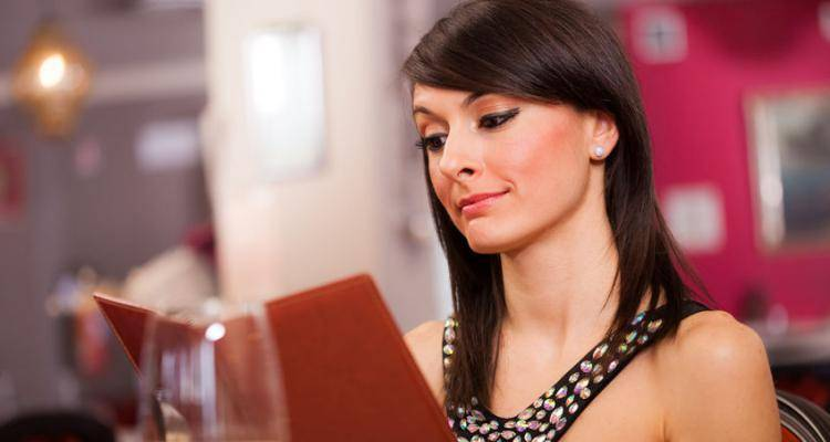 lady reading menu in restaurant