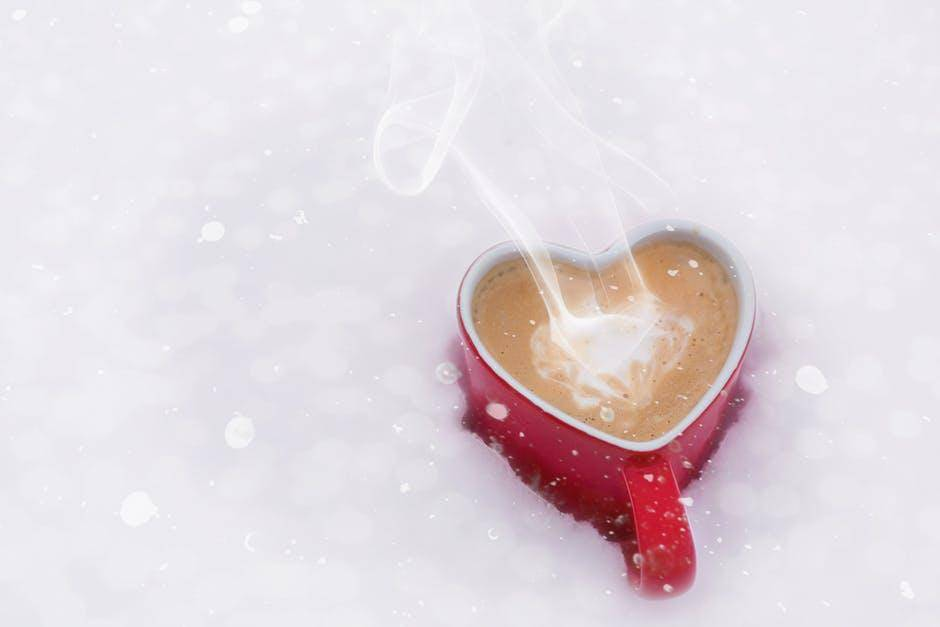 love shaped steaming cup of coffee
