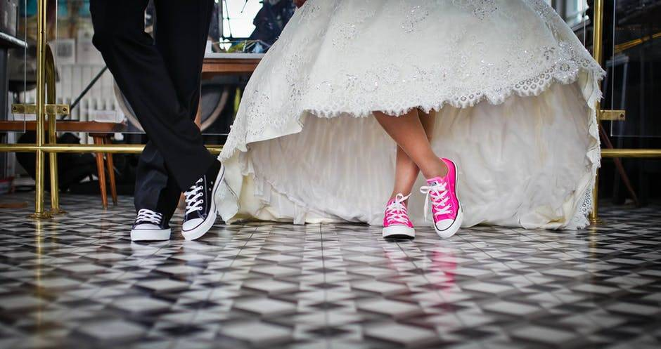 pink shoes under wedding gown