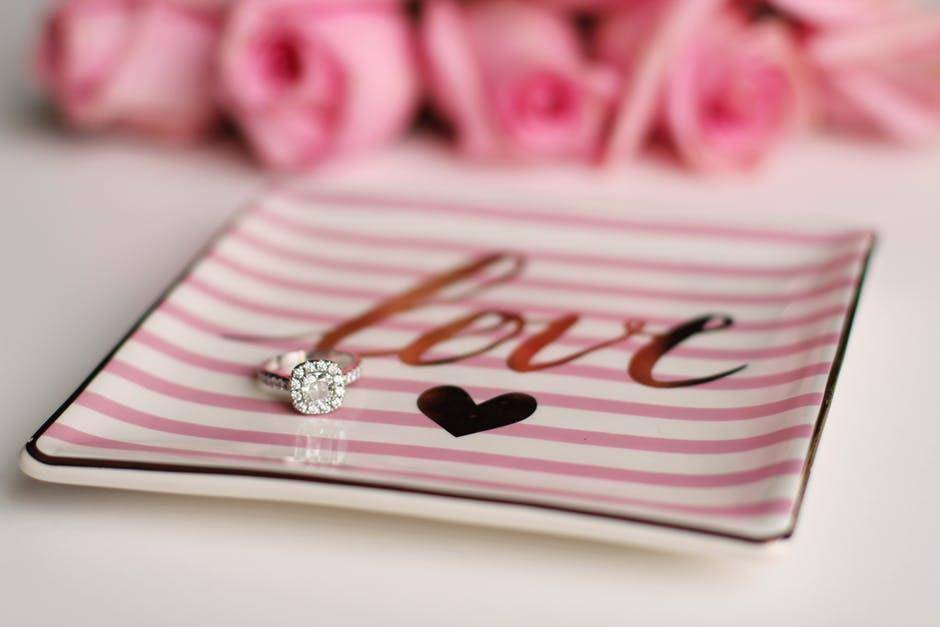 wedding ring on dish inscribed with love