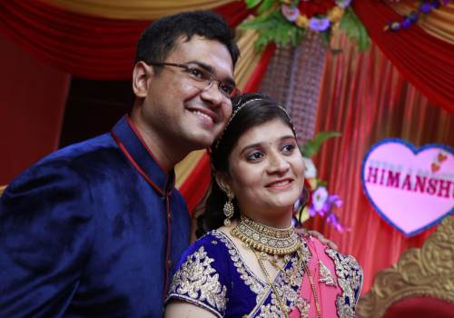 Himanshu with her wife on their wedding day