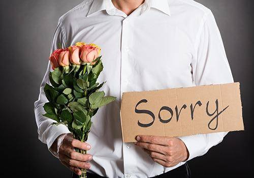 apologizing man