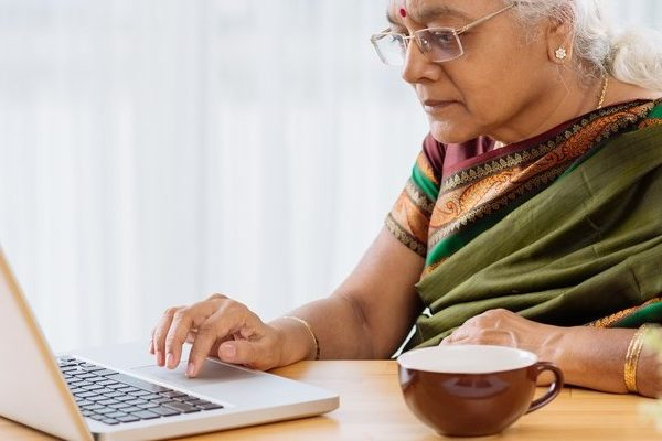 elderly-Indian-woman-with-a-laptop