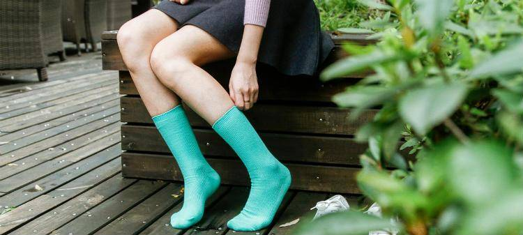 Girl with green socks