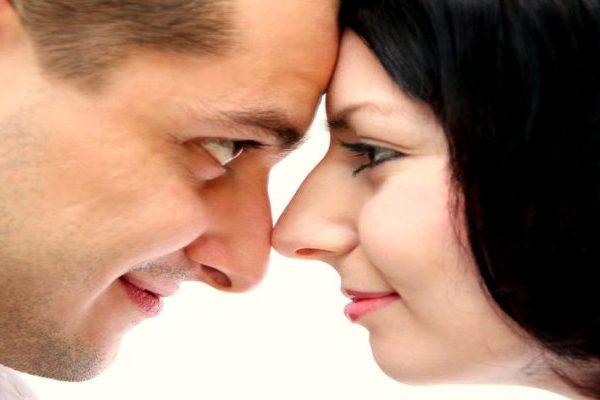 man and woman looking at each other