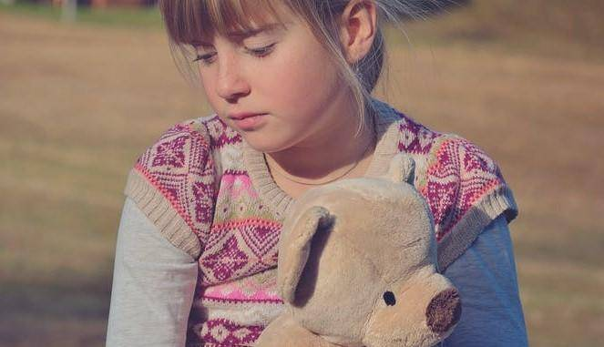 sad girl with teddy