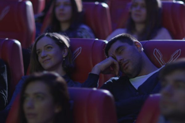 Husband sleeping in a theatre