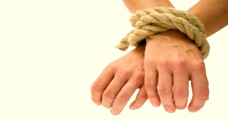 man hands tied with rope