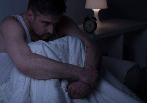 man thinking in his bed
