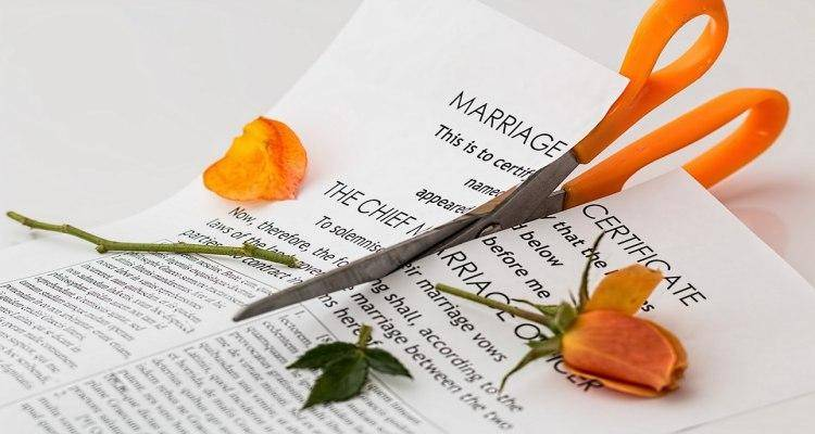 Marriage certificate being cut into two