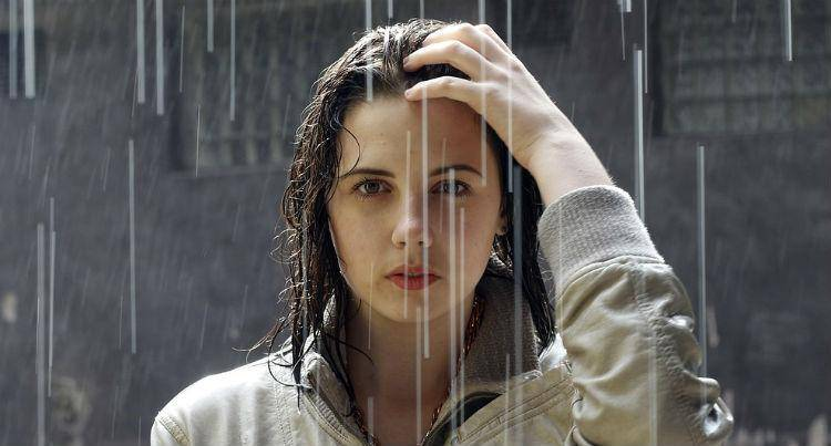 Beautiful woman in rain