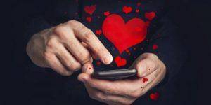 man texting after first date
