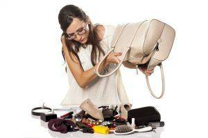 woman emptying purse