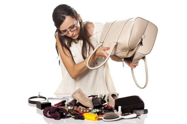 woman-emptying-purse