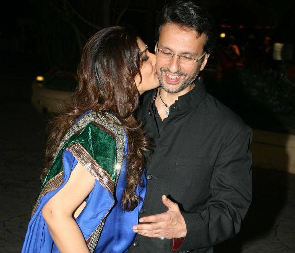 Raveena kisses husband
