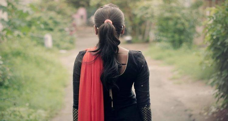 The back of a girl in Indian wear