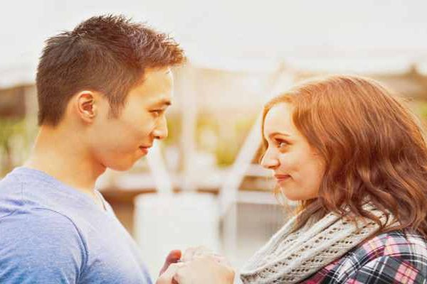 Young-couple-affectionately-facing-each-other