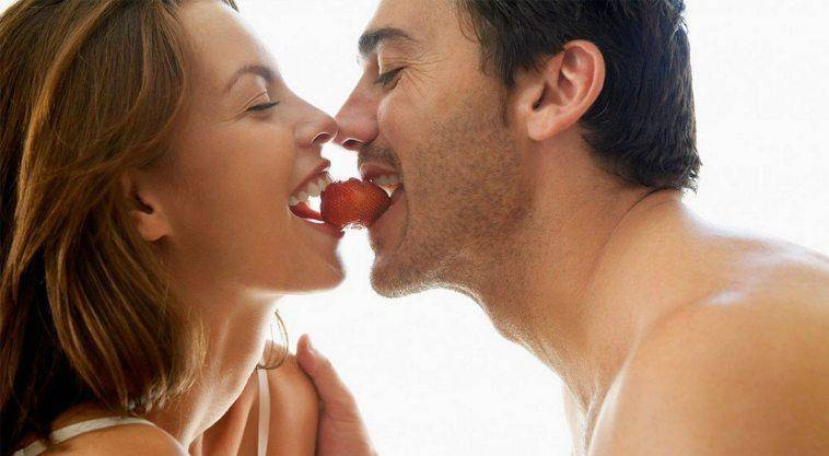 couple playing with fruits