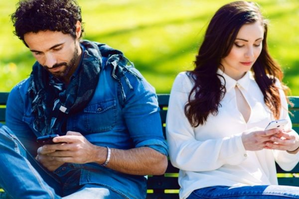 couple using smartphone