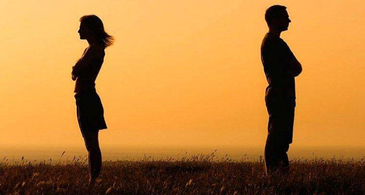 Silhouette of a man and woman facing away from each other