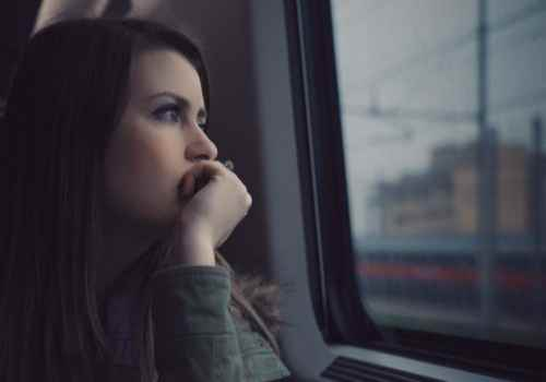 lady thinking when seeing outside of window