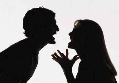 man abusing woman silhouette